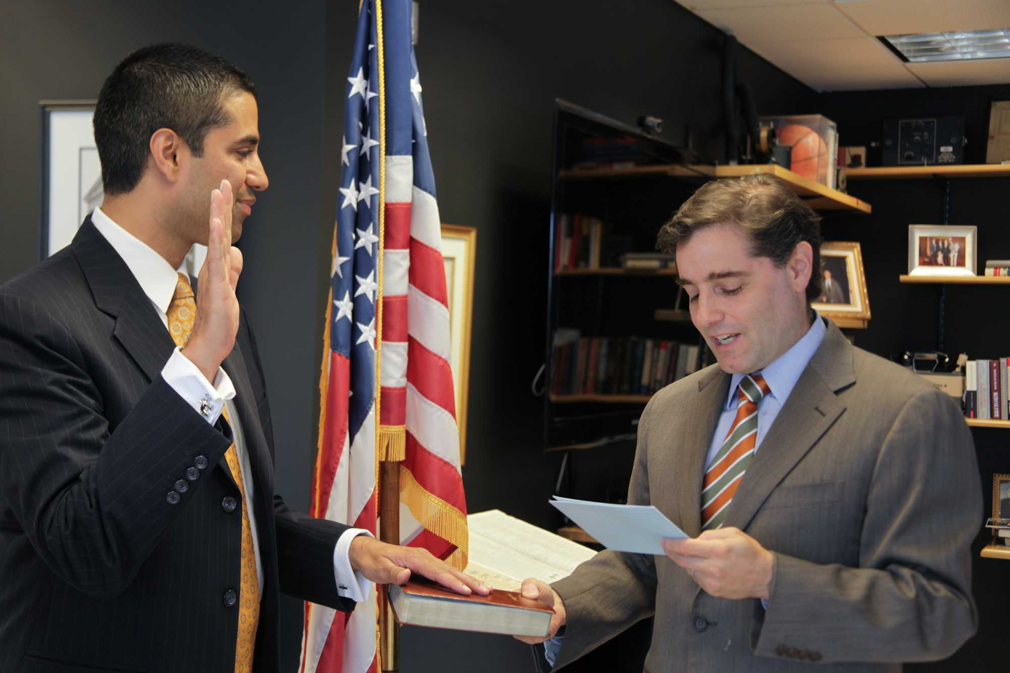 FCC Chairman Genachowski swearing in Ajit Pai as the new Commissioner at the FCC headquarters in Washington, DC.  May 14, 2012. [Federal Communications Commission Photo]