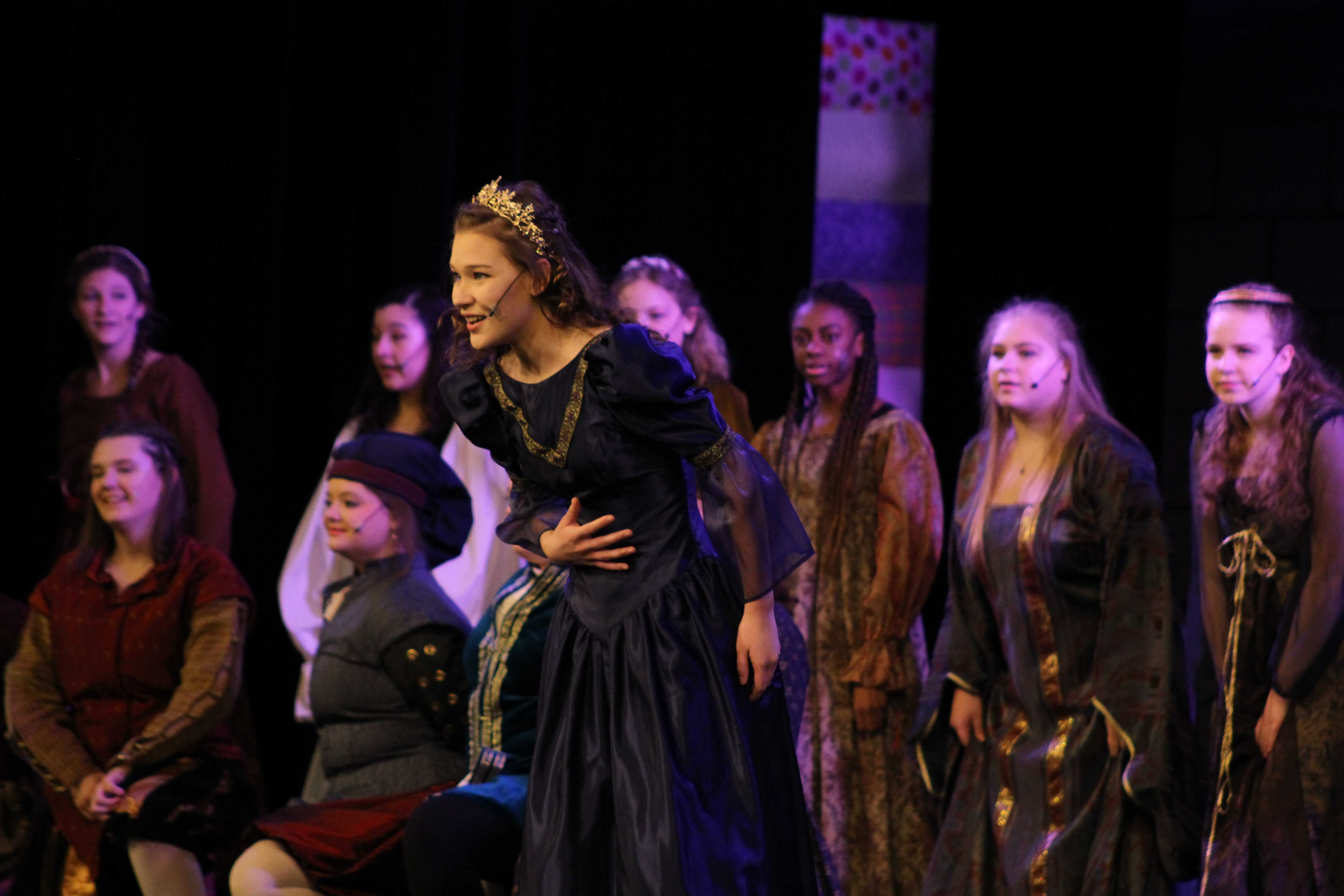 Princess Winnifred (played by senior Anna Skala) making eye contact with the audience as she is acting. (K. Troy)