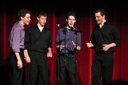 Seniors Christian Aldridge, Brody Burkhart, Chris O' Meara, and Zach Polentini (left to right) sing in the Winter Variety Show. (Hannah Sturckey, Voice)