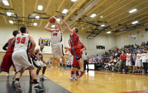 Last-second lay up shot gives Huntley win, conference championship