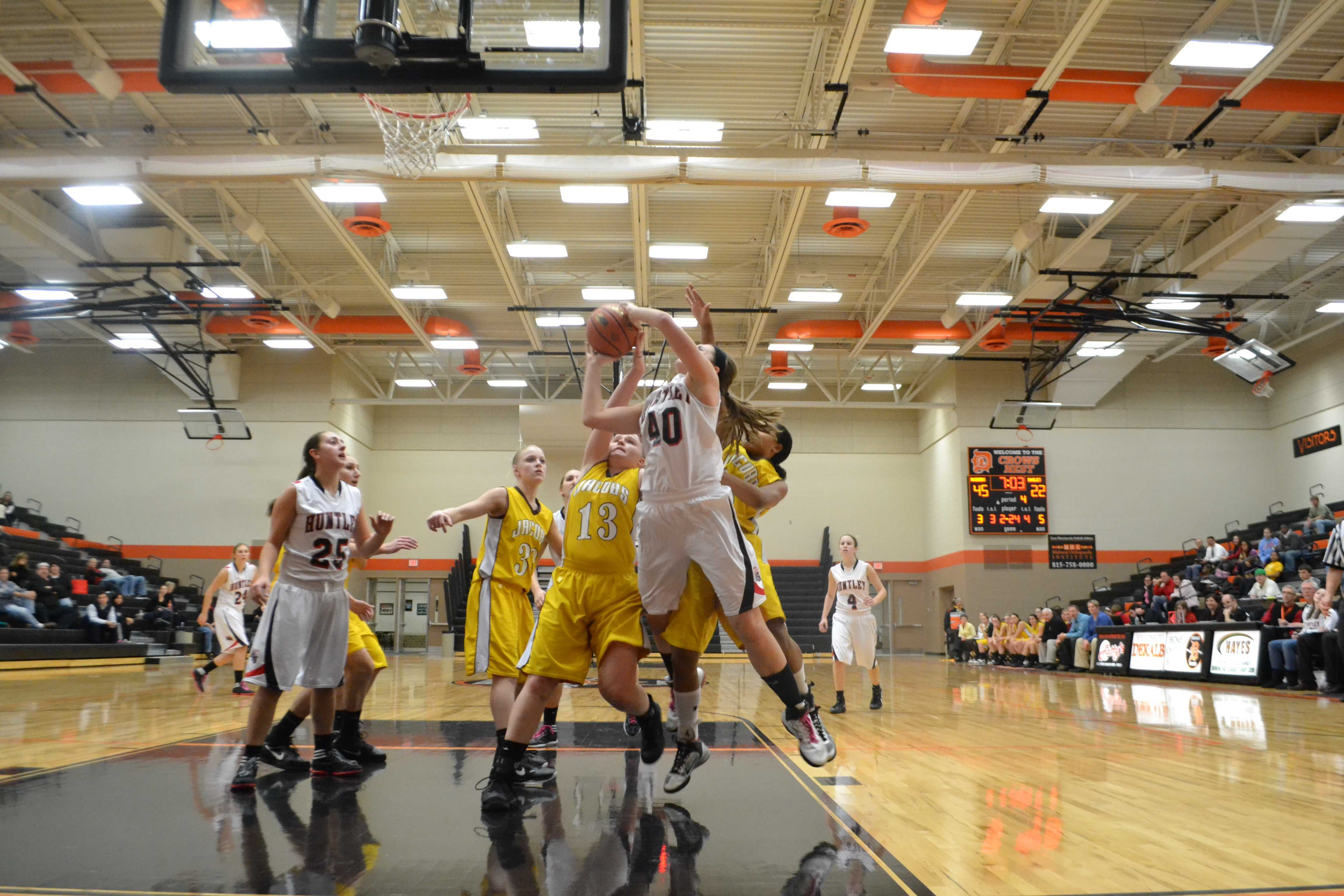 Huntley Red Raiders player attempts to score against the Jacobs Golden Eagles (M. Krebs).