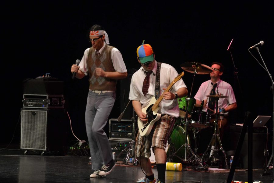 Spazmatics wear comedic hats and outfits during their performance in Huntley High School's PAC (M. Makowski).
