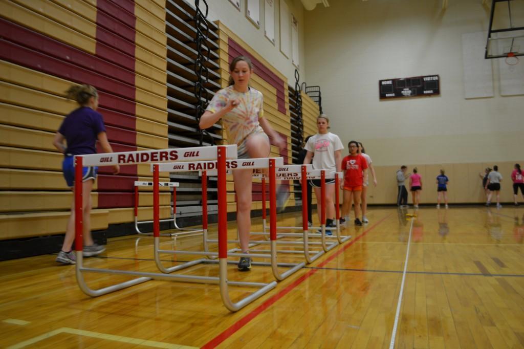 Junior Kaitlyn Luebke jumps hurdles during track practice (S.Murk).