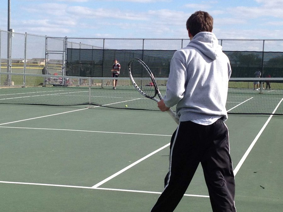 Huntley boys tennis defeats Woodstock North