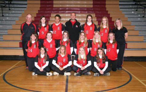 The girls softball team keep their spirits high despite a weak season ( photo courtsey to HHS archives).