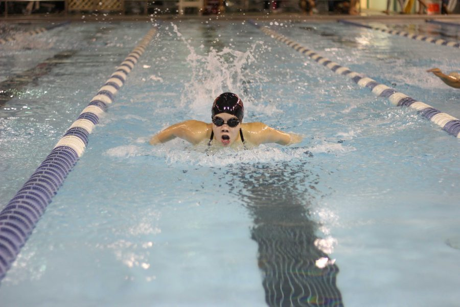 Girls swimming sinks against Jacobs