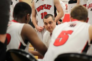 Coach Martin Manning speaks with his players during a timeout. Mike Krebs/ The Voice