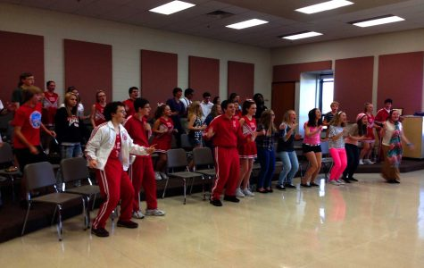The cast warms up in the choir room before taking the stage at their Sunday performance.