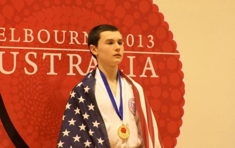 Allare stands with his gold medal (photo courtesy of J. Allare).
