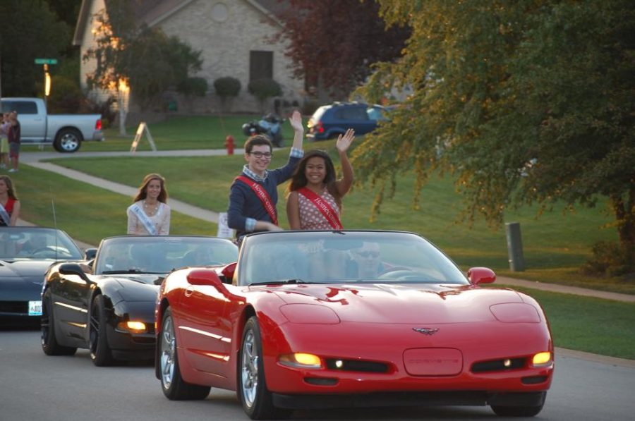 Junior Homecoming representatives Jess Clavero and Spencer Bingham ride down the parade route in style. Photo courtesy of Jess Clavero.