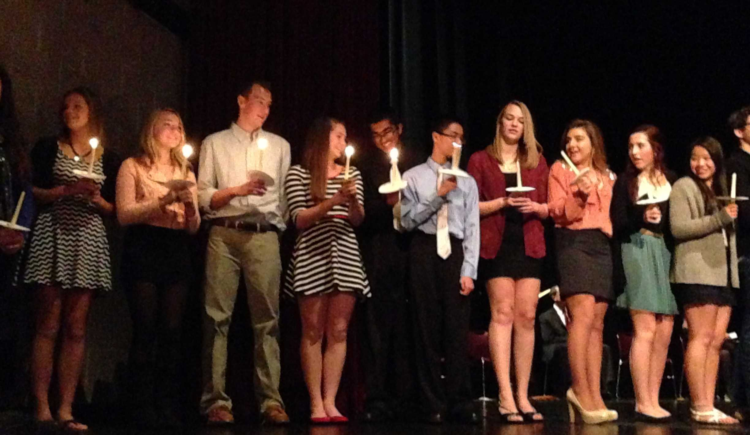 Inductees pass along the flame of knowledge (H. Baldacci).
