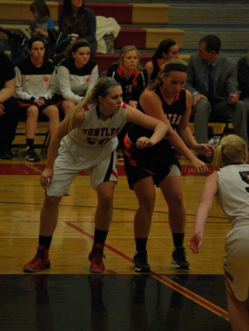 Huntley blows out Central in opening game