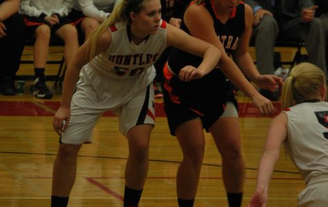 Sophomore Ali Andrews boxes out a Central player before going for a rebound.