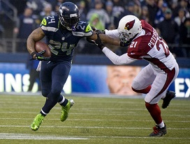 Seattle Seahawks running back Marshawn Lynch, left, stiff arms Cardinals cornerback Patrick Peterson in the fourth quarter at CenturyLink Field in Seattle, Sunday, Dec. 22, 2013. The Cardinals beat the Seahawks, 17-10. (Joe Barrentine/Tacoma News Tribune/MCT)