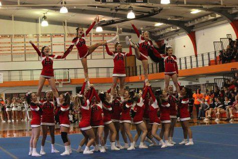 Varsity cheerleading team takes third at CLC invite