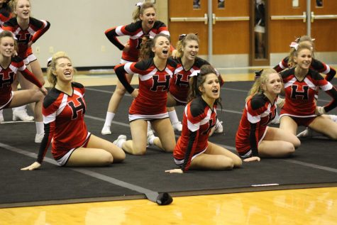 Varsity Cheerleading team takes home the conference title for the third year in a row