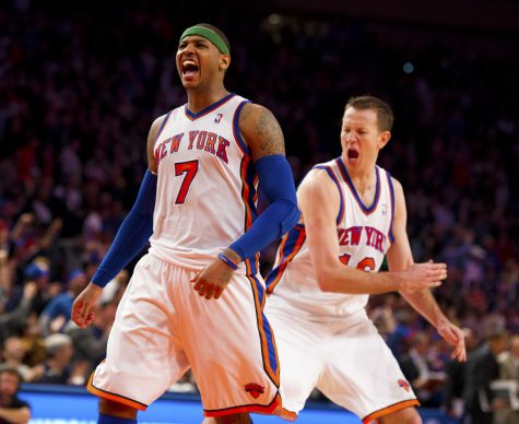 New York Knicks' Carmelo Anthony celebrates with Steve Novak after scoring the tying basket against the Chicago Bulls to send the game into overtime at Madison Square Garden in New York, Sunday, April 8, 2012. The Knicks beat the Bulls, 100-99 in overtime. (Errol Anderson/Newsday/MCT)