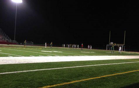 Huntley defends free kick taken by Crystal Lake South.