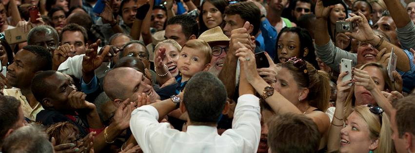 President Barack Obama shakes hands with voters in a local area (Courtesy of www.facebook.com/barackobama/photos).