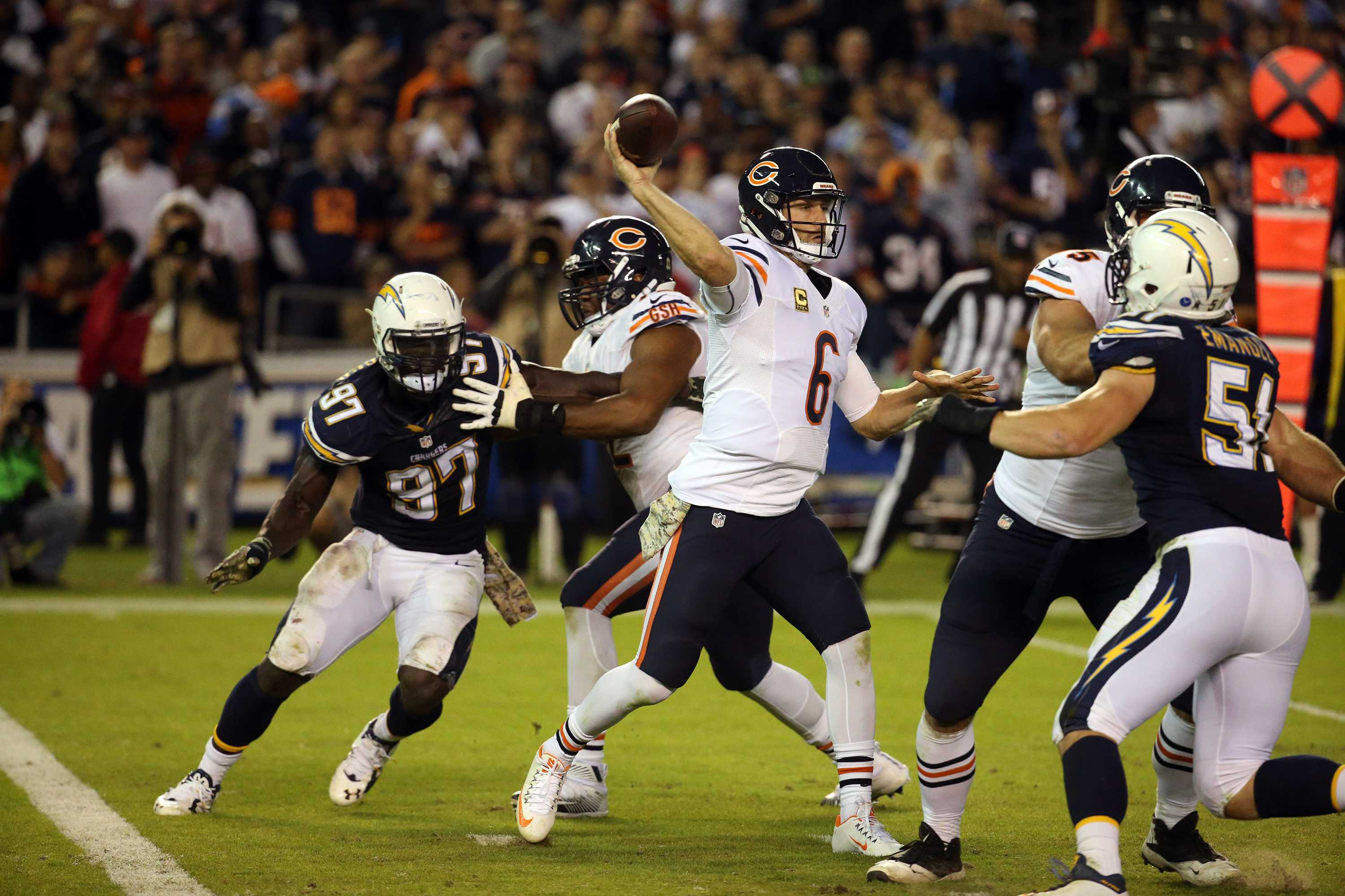 Chicago Bears quarterback Jay Cutler (6) passes as San Diego Chargers outside linebacker Jeremiah Attaochu (97) rushes during the third quarter on Monday, Nov. 9, 2015, at Qualcomm Stadium in San Diego. (Brian Cassella/Chicago Tribune/TNS)