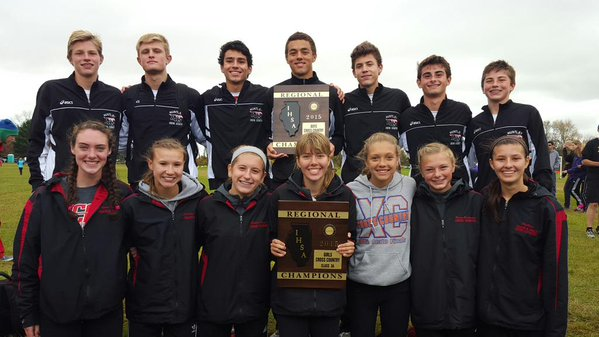 The boys and girls cross country teams pose with their regional championship plaques.