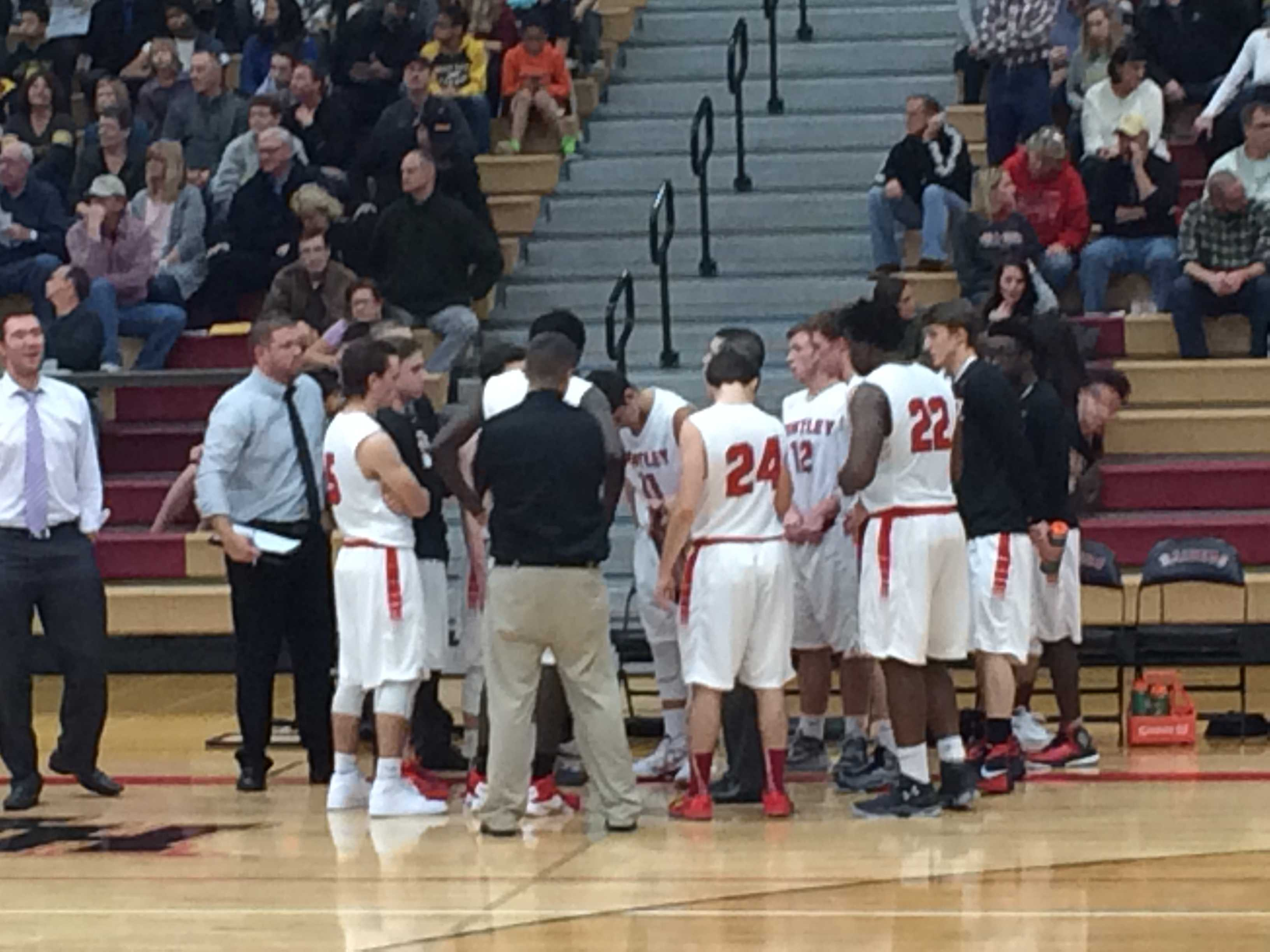 The Red Raiders huddle during their game against Jacobs.