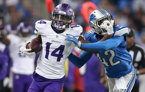 Minnesota Vikings wide receiver Stefon Diggs (14) stiff arms Detroit Lions strong safety Isa Abdul-Quddus (42) as he picks up a first down during the second quarter on Sunday, Oct. 25, 2015, at Ford Field in Detroit. (Jerry Holt/Minneapolis Star Tribune/TNS)