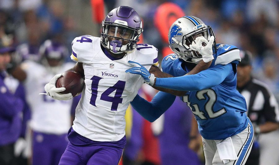 Minnesota+Vikings+wide+receiver+Stefon+Diggs+%2814%29+stiff+arms+Detroit+Lions+strong+safety+Isa+Abdul-Quddus+%2842%29+as+he+picks+up+a+first+down+during+the+second+quarter+on+Sunday%2C+Oct.+25%2C+2015%2C+at+Ford+Field+in+Detroit.+%28Jerry+Holt%2FMinneapolis+Star+Tribune%2FTNS%29