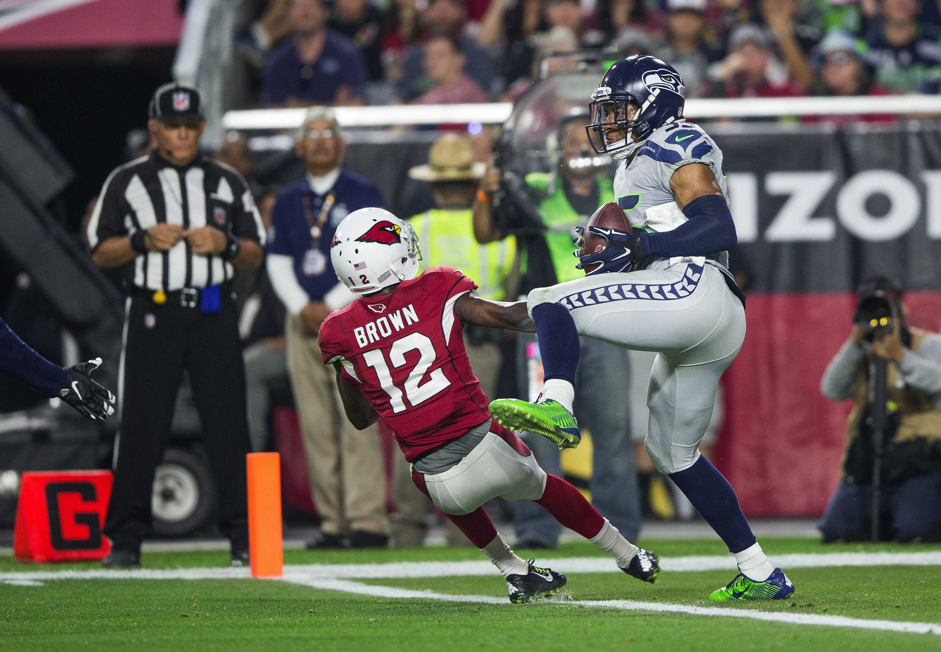 Seattle Seahawks' DeShawn Shead intercepts a pass intended for Arizona Cardinals' John Brown at the goal line during the fourth quarter on Sunday, Jan. 3, 2016, at University of Phoenix Stadium in Glendale, Ariz. (Dean Rutz/Seattle Times/TNS)
