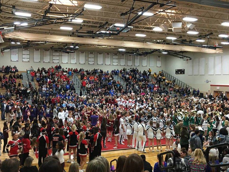 Various cheer teams fill up the East Gym for Huntley's Sweetheart Invitational.