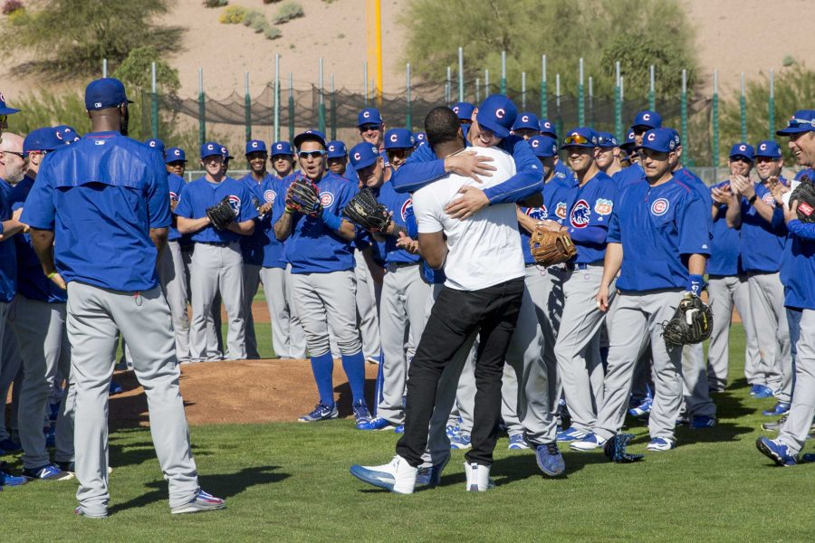 Chicago+Cubs+first+baseman+Anthony+Rizzo+hugs+Dexter+Fowler+after+Fowler+made+a+surprise+appearance+during+Cubs+spring+training+at+Sloan+Park+in+Mesa%2C+Ariz.%2C+on+Thursday%2C+Feb.+25%2C+2016.+Fowler+has+agreed+to+a+one-year+contract+with+a+mutual+option+with+the+Cubs.+%28Armando+L.+Sanchez%2FChicago+Tribune%2FTNS%29