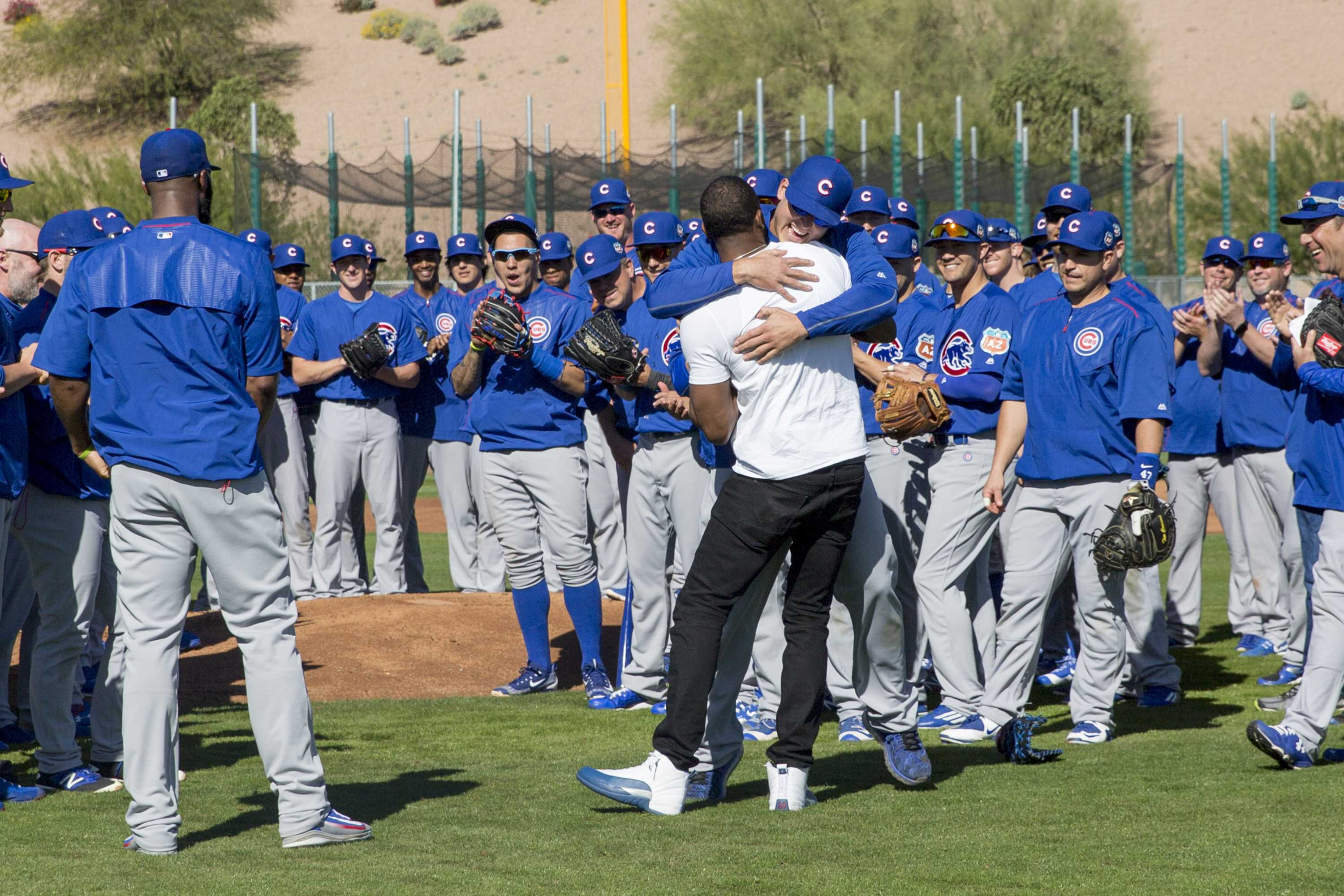 Chicago Cubs first baseman Anthony Rizzo hugs Dexter Fowler after Fowler made a surprise appearance during Cubs spring training at Sloan Park in Mesa, Ariz., on Thursday, Feb. 25, 2016. Fowler has agreed to a one-year contract with a mutual option with the Cubs. (Armando L. Sanchez/Chicago Tribune/TNS)