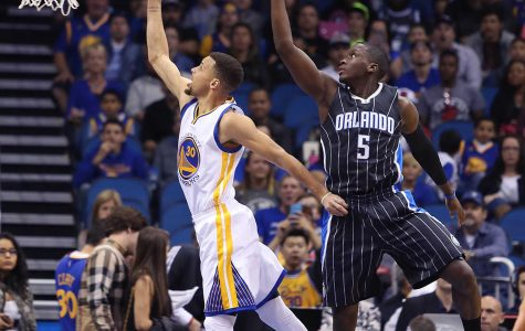 The Golden State Warriors' Stephen Curry (30) scores past the Orlando Magic's Victor Oladipo (5) at the Amway Center on Thursday, Feb. 25, 2016, in Orlando, Fla. (Stephen M. Dowell/Orlando Sentinel/TNS)