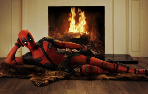 Deadpool lounging by the fire (Courtesy of fox-movies.com).