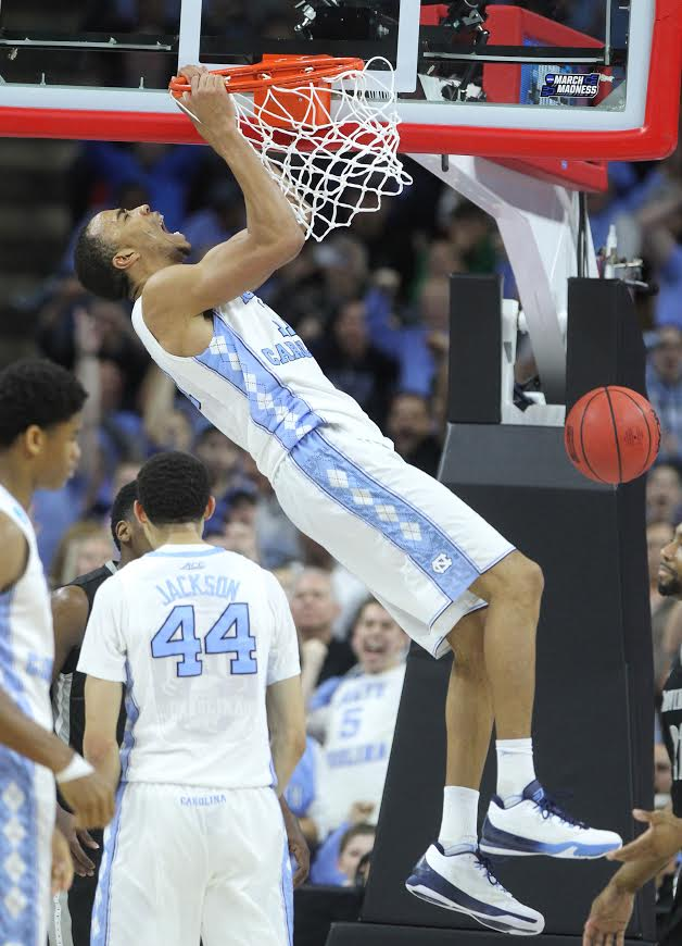 North Carolina's Brice Johnson (11) screams after slamming in two during the second half against Providence in the second round of the NCAA Tournament at PNC Arena in Raleigh, N.C., on Saturday, March 19, 2016. North Carolina advanced, 85-66. (Ethan Hyman/Raleigh News & Observer/TNS)