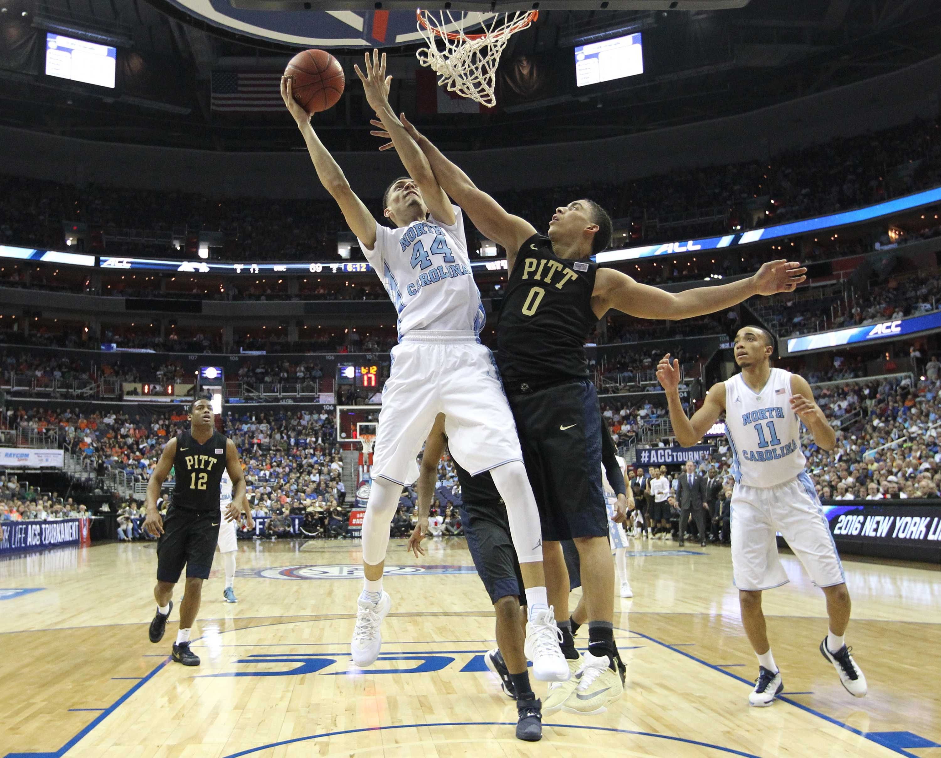 North Carolina's Justin Jackson (44) shoots as Pittsburgh's James Robinson (0) defends during the second half of the quarterfinals of the 2016 New York Life ACC Tournament on Thursday, March 10, 2016, at the Verizon Center in Washington, D.C. (Ethan Hyman/Raleigh News & Observer/TNS)