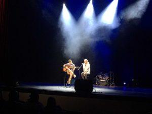 Juniors Cameron Nachreiner and Alyssa Debock perform an acoustic duet on stage (C. Thomas).