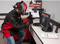 Student experiences welding through a virtual reality arc welding simulator (Coutesy of mchnery.edu).
