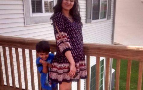 Junior Pooja Mangukiya poses on the deck of her new Talamore house (Courtesy of P. Mangukiya)