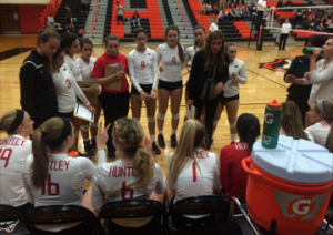 Coach Karen Naymola talks to her team during a time-out in the regional final (E. Kubelka).