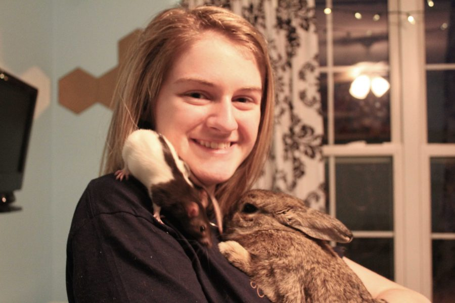 Geraci and 3 of her 17 pets (E. Kindl).