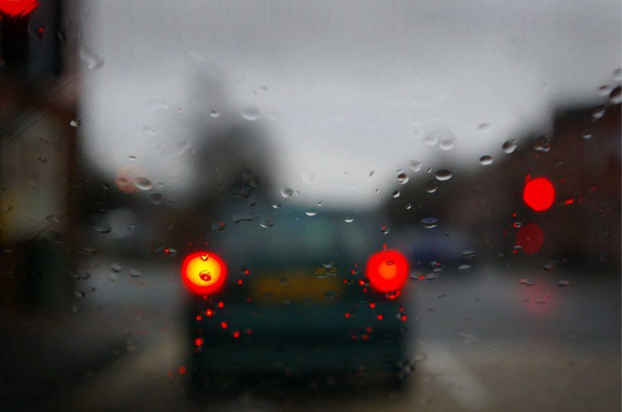 A car waiting at a red light (Steve Garry).