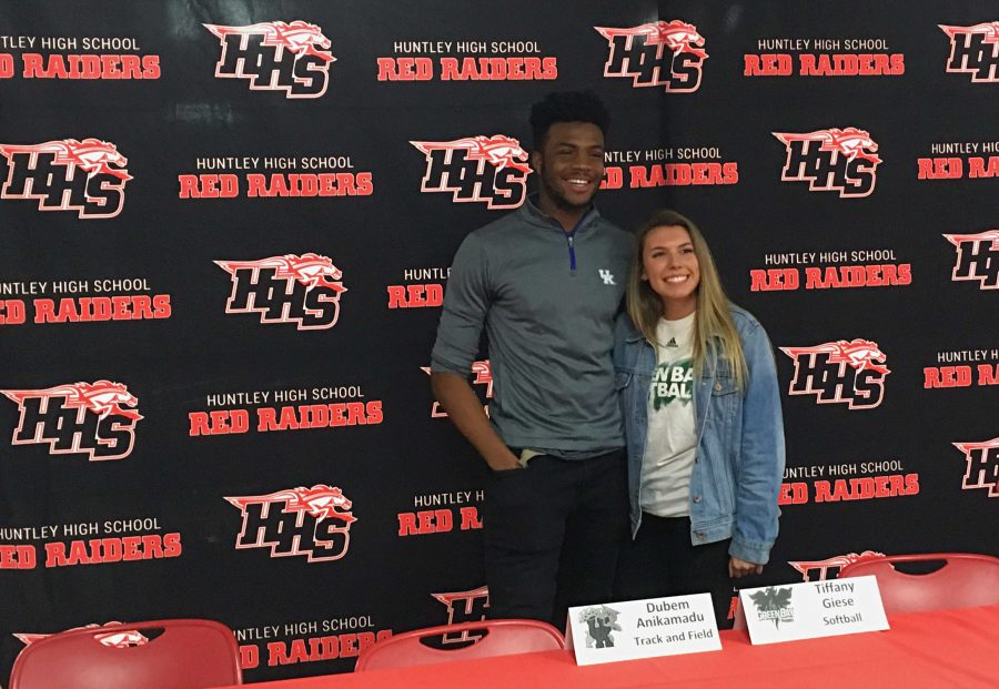 Dubem Anikamadu and Tiffany Giese posing together for pictures after signing. (E. Kindl)