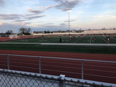 Varsity girls lacrosse team puts up a fight against Mundelein High School