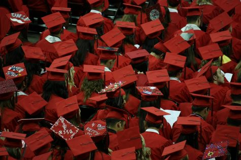 A change of tradition: Huntley's single-colored graduation gowns cause controversy