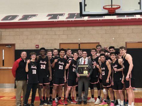 Raiders soar over the J-Hawks at varsity boys basketball regional finals