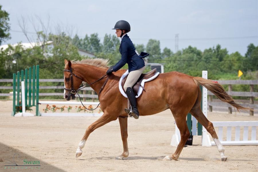 Ashley Tomlinson rides her horse around the trail