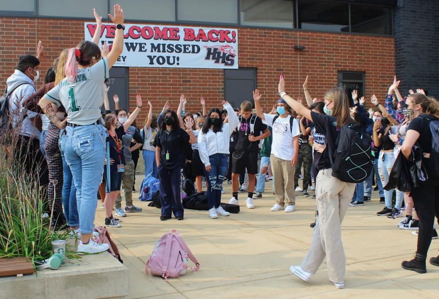 Cortez and Anderson asked the walkout participants to raise their hands if they had experienced sexual harassment. (Photo by A. Cobb)