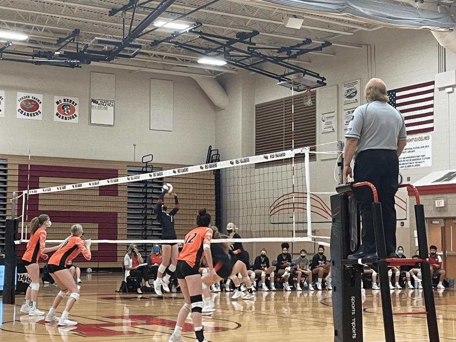 Junior Maggie Duyos setting the ball for an incredible spike. (M. Curry)